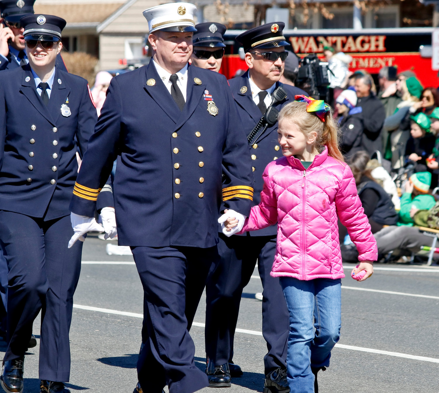 Seaford Fire Department Assistant Chief Thomas DeHaan marched with his daughter Lauren.
