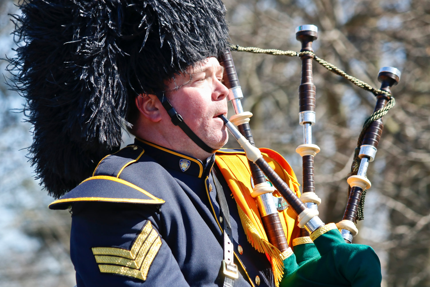 NYPD Emerald Soceity bagpiper Sgt. Danny O'Connell played the pipes along the route.