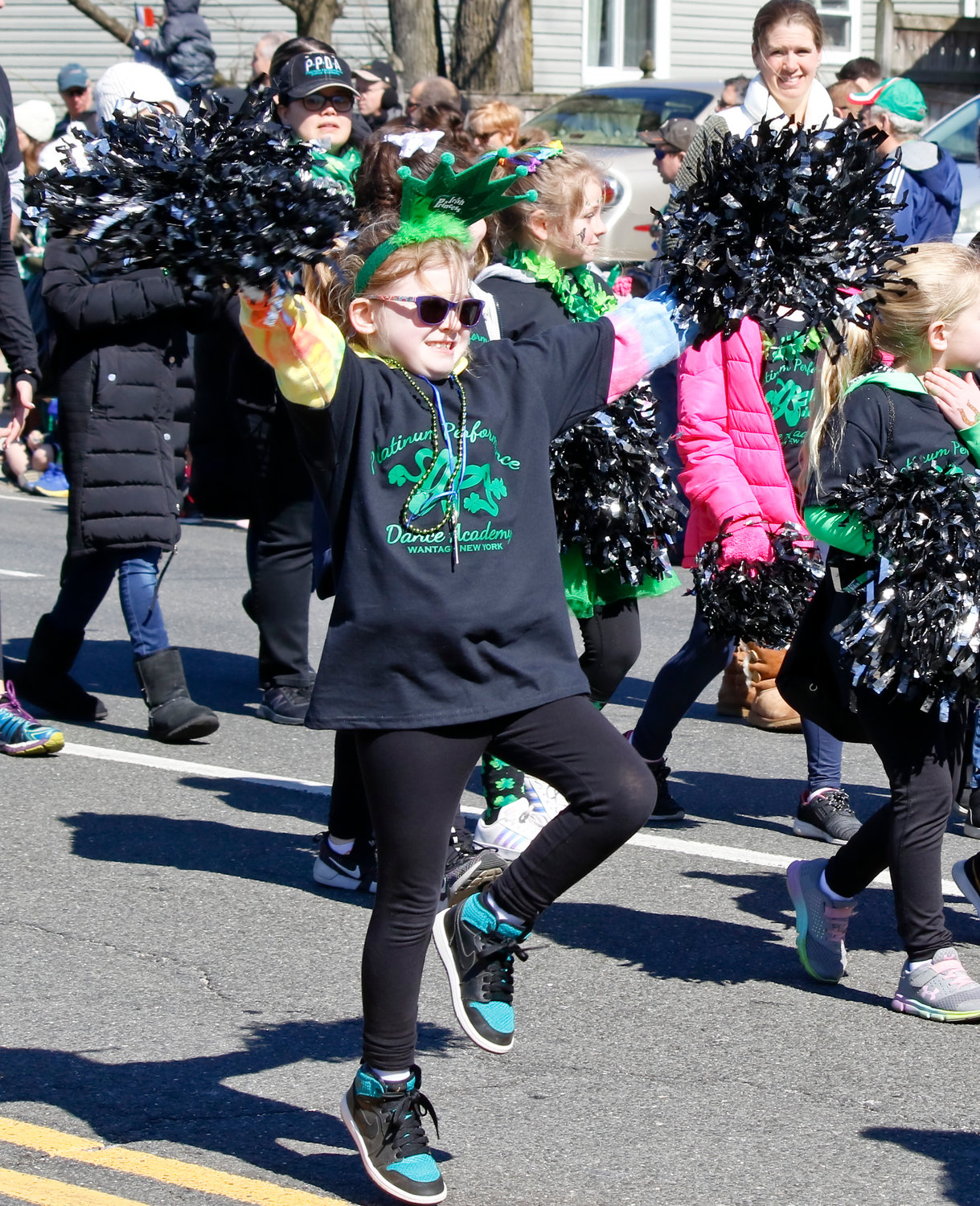 Dancer Megan Kelly, from Platinum Performance Dance Academy in Wantagh, spread St. Patrick's Day cheer along the route.