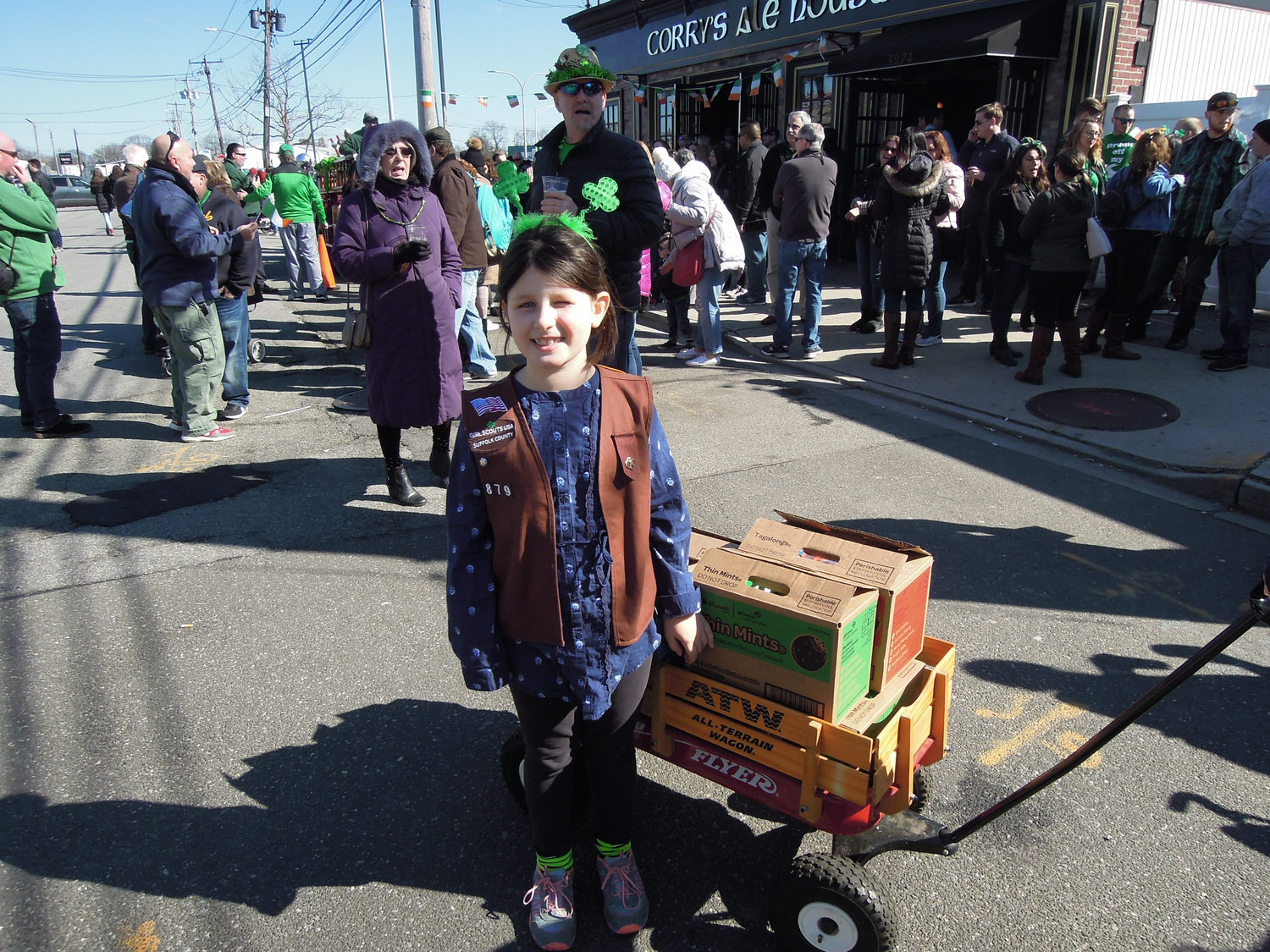 Budding entrepreneur and Brownie Girl Scout Darcy Rimkunas, 9, of Huntington, was visiting her Irish grandmother and decided to capitalize on the parade to sell cookies.