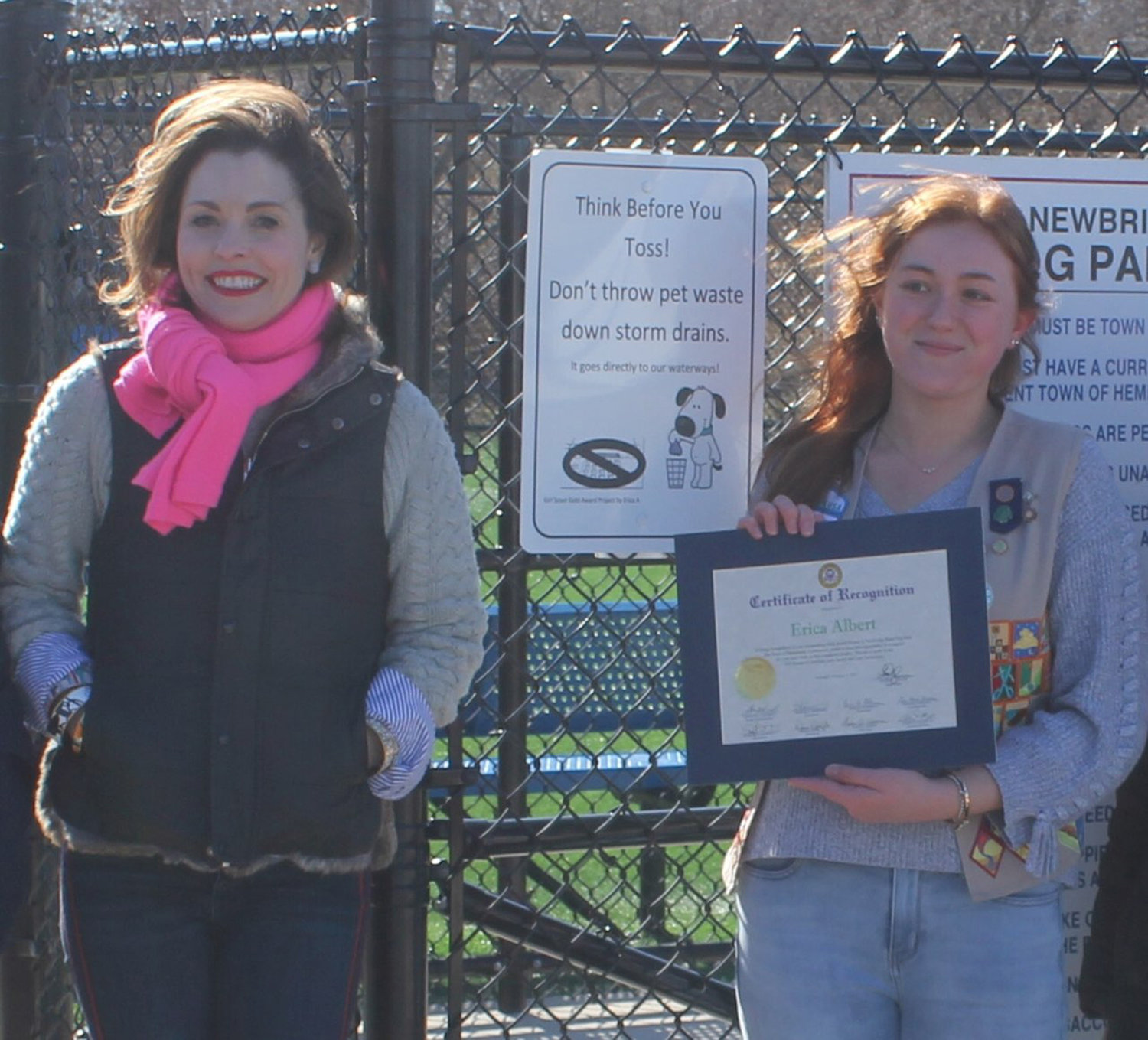 Erica Albert, right,  with Town Councilwoman Erin King Sweeney beside one of Albert's signs in Newbridge Park.