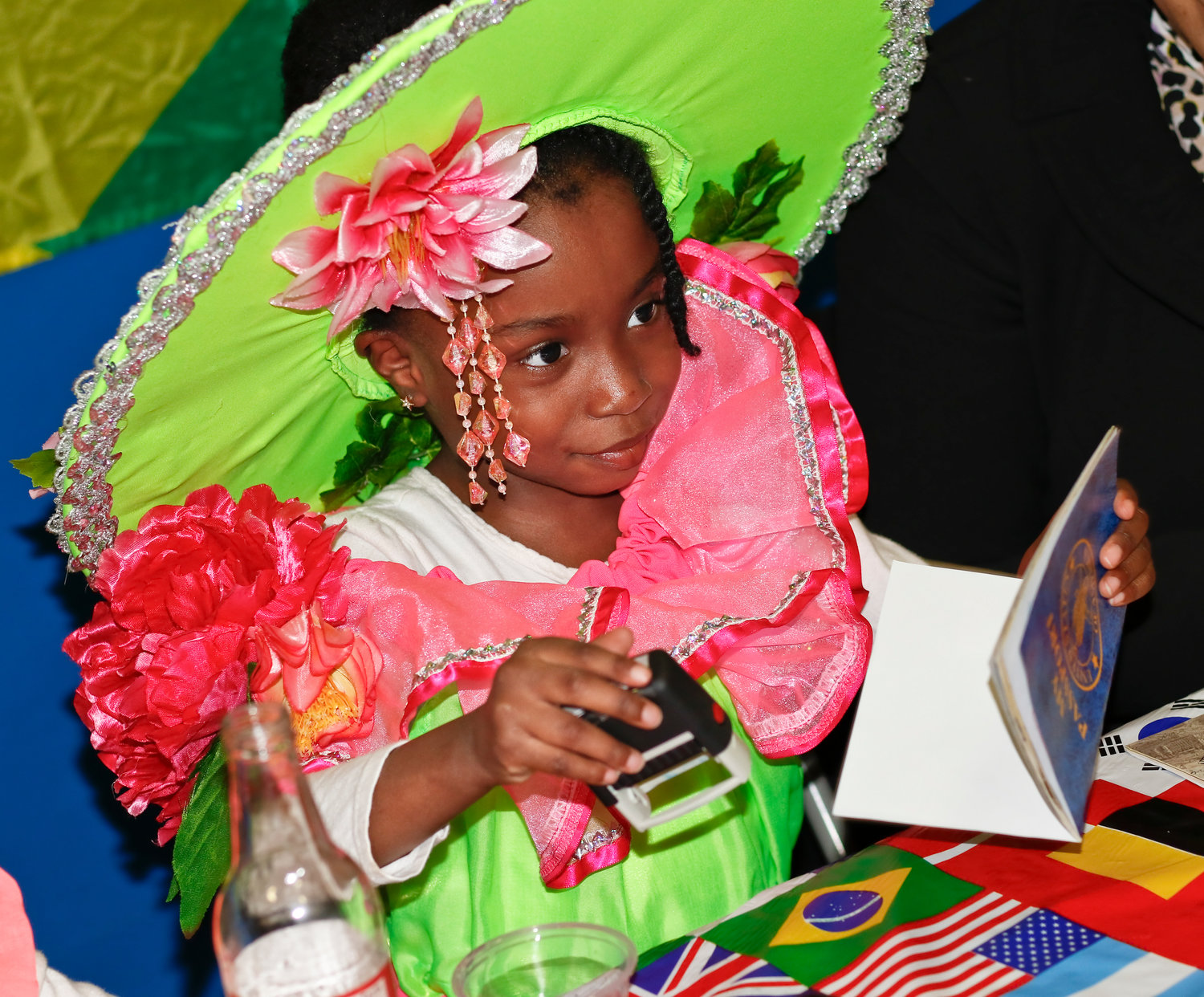 Representing Trinidad and Jamaica, Kaitlyn John, 4, a student at FECC stamped passports dressed in garb for Carnival season.