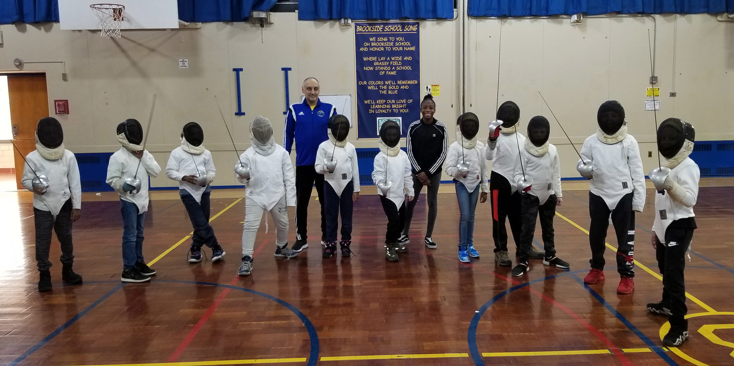 Brookside Elementary school recently started a fencing club. Students have been taking classes under the instruction of Boris Khugrin, and with the encouragement of Annie Doresca.