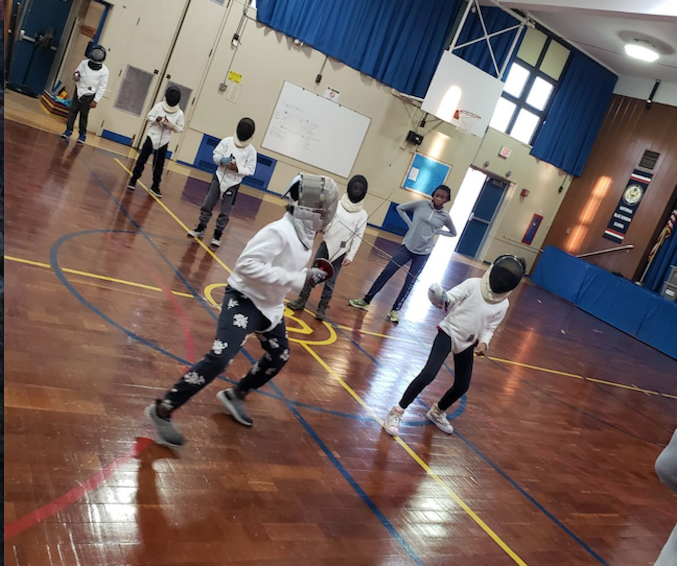 Students took turns lunging at their opponents, working on footwork and striking techniques.