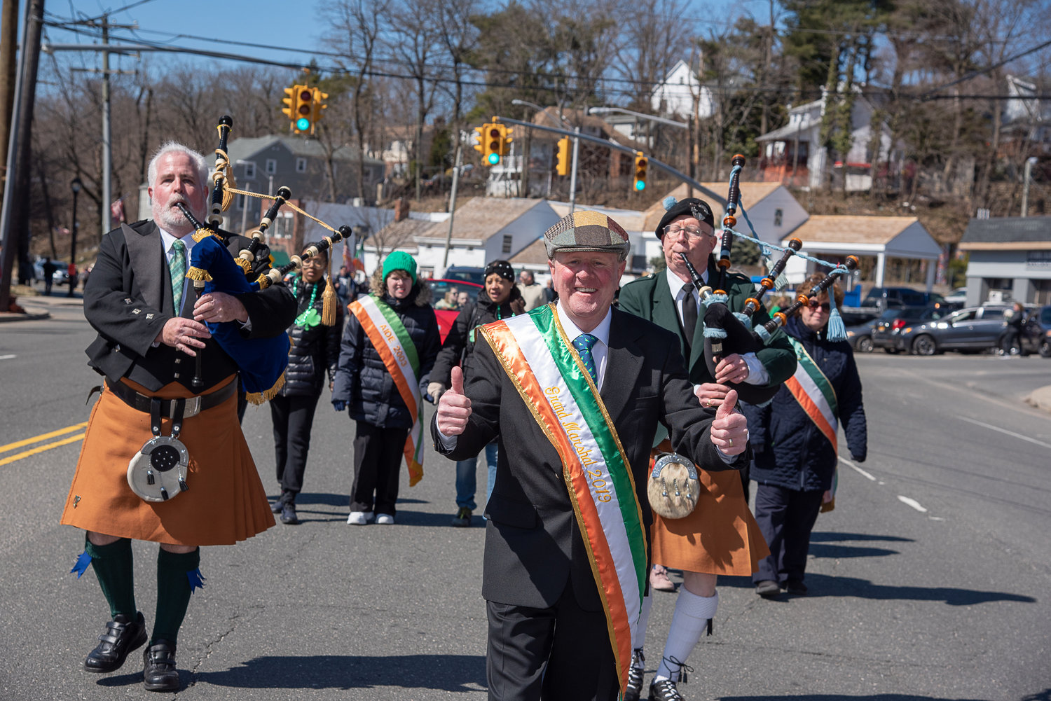 Parade Grand Marshal Patrick Furlong's exuberance set the tone for the St. Patrick's Day Parade in Glen Cove on Sunday.