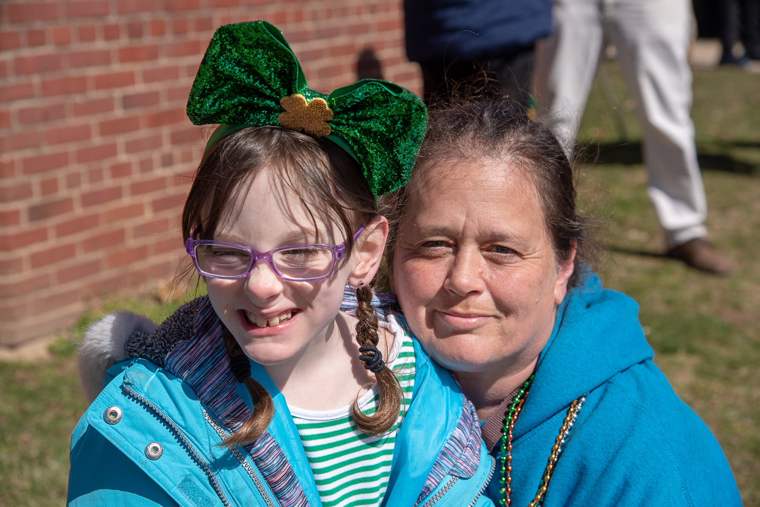 Brianna Hood and her mother, Donna, waited at Finley Middle School for the cannon shot that signaled the start of the parade.