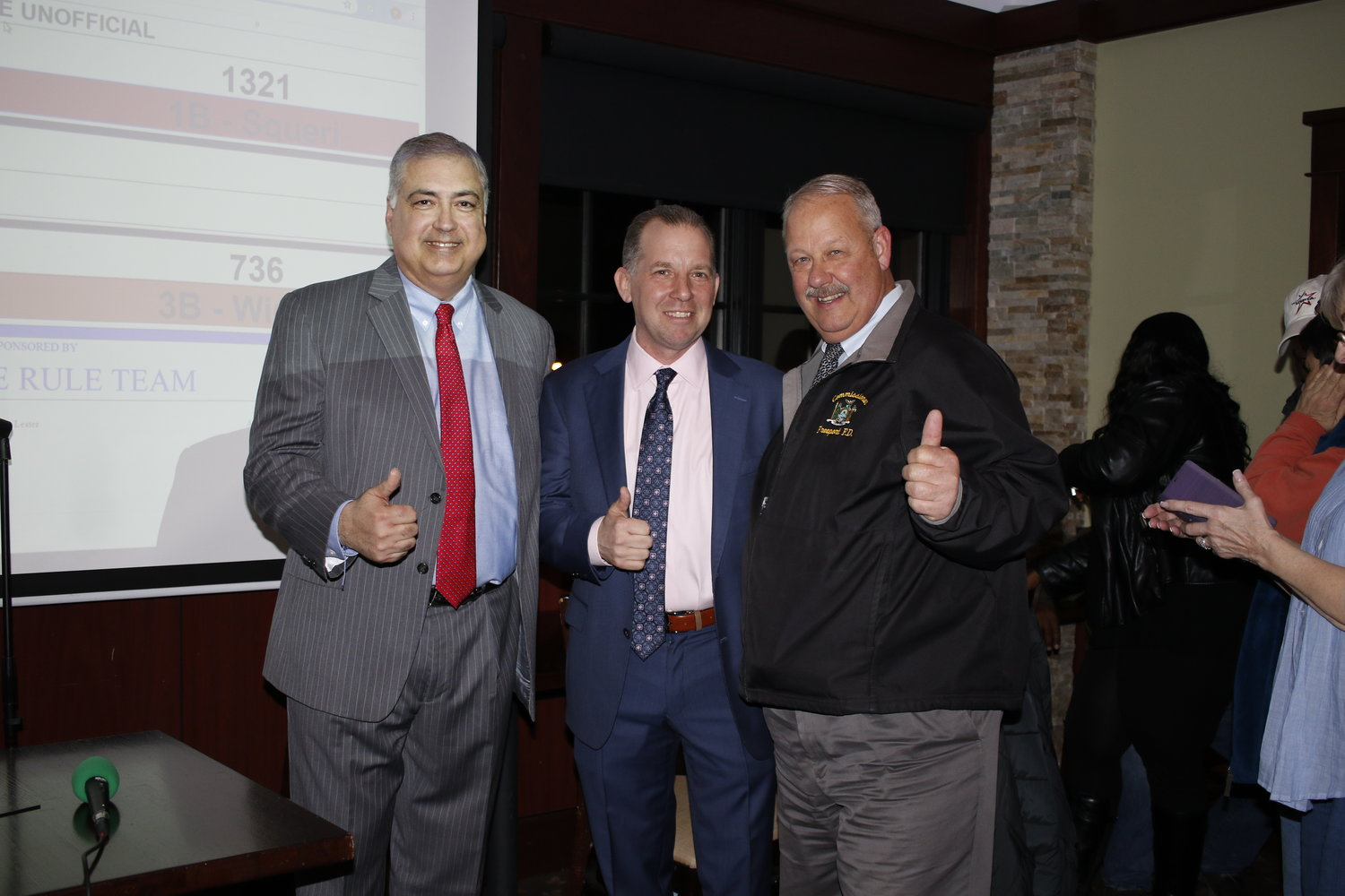 After the village election results were announced incumbent Deputy Mayor Jorge Martinez, left, newly elected Board of Trustee Chris Squeri, and   Mayor Robert Kennedy gave a thumbs up of approval.