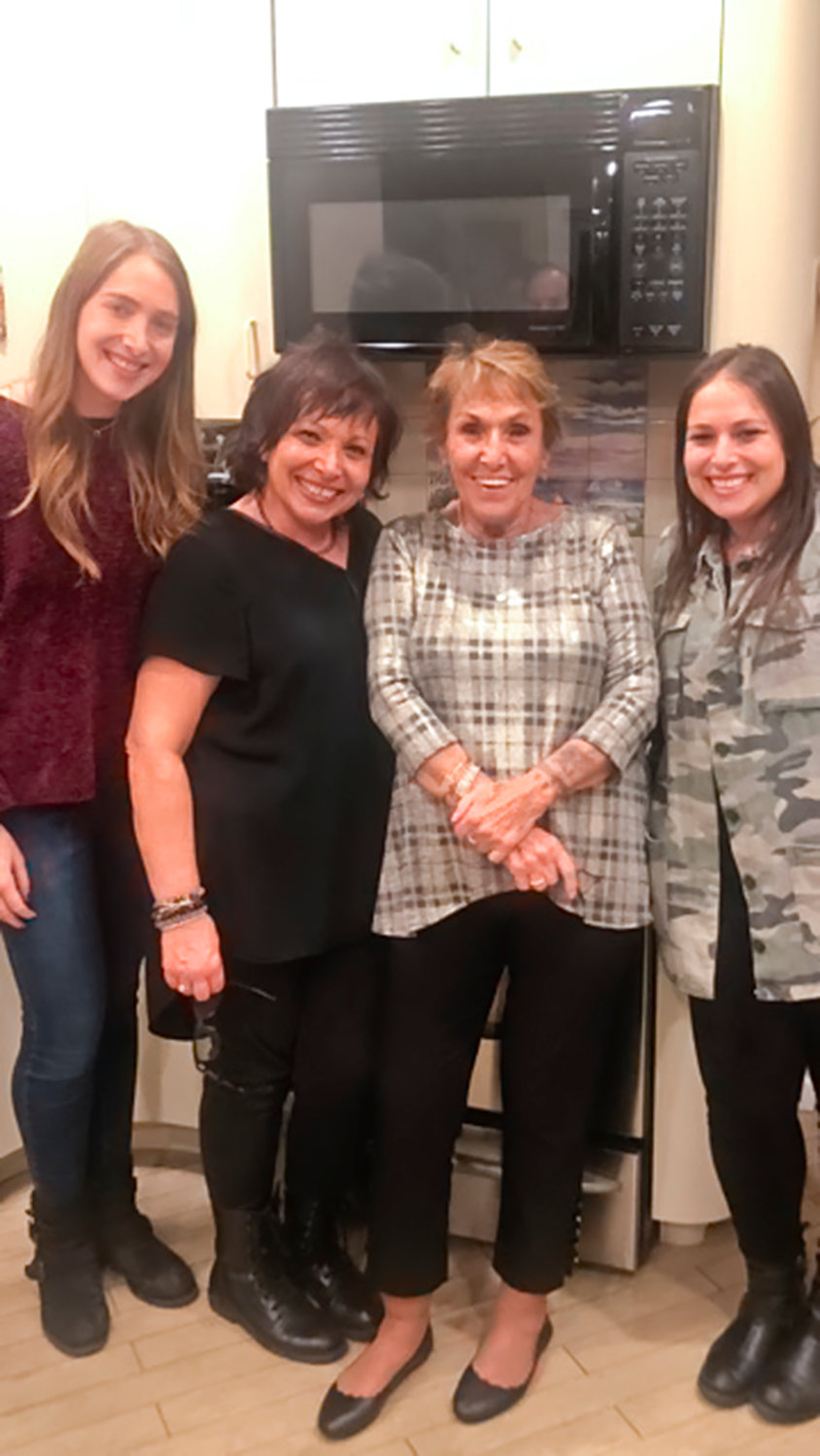 "Marion Blane's Daughters Shelby, far left, and Jaclyn, far right, joined Blane, second from left, when she first met her birth mother, Sharyn Friedman. ""They both just kept smiling,"" Jaclyn recalled."