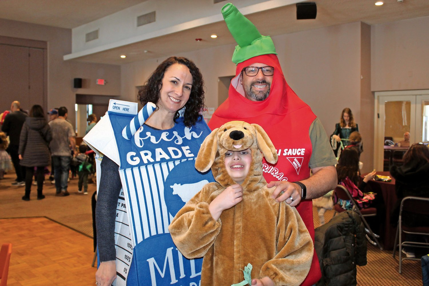 Debbie, Peter and Matthew Ilberg, of Glen Head, came prepared for the Purim carnival in silly costumes.