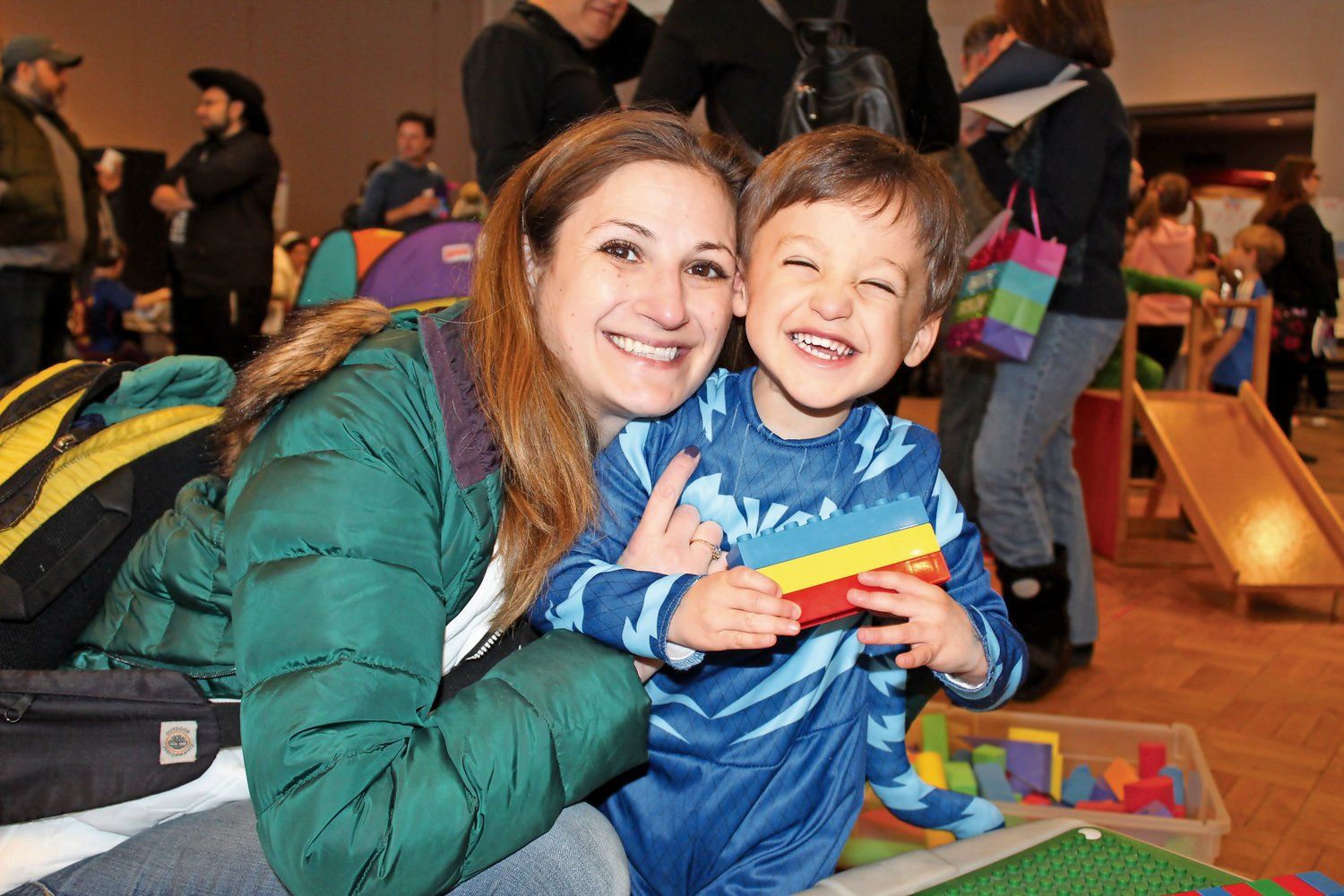 Glen Cove resident Jenna Miller and her son, Hunter, 3, played with LEGOs at the carnival.