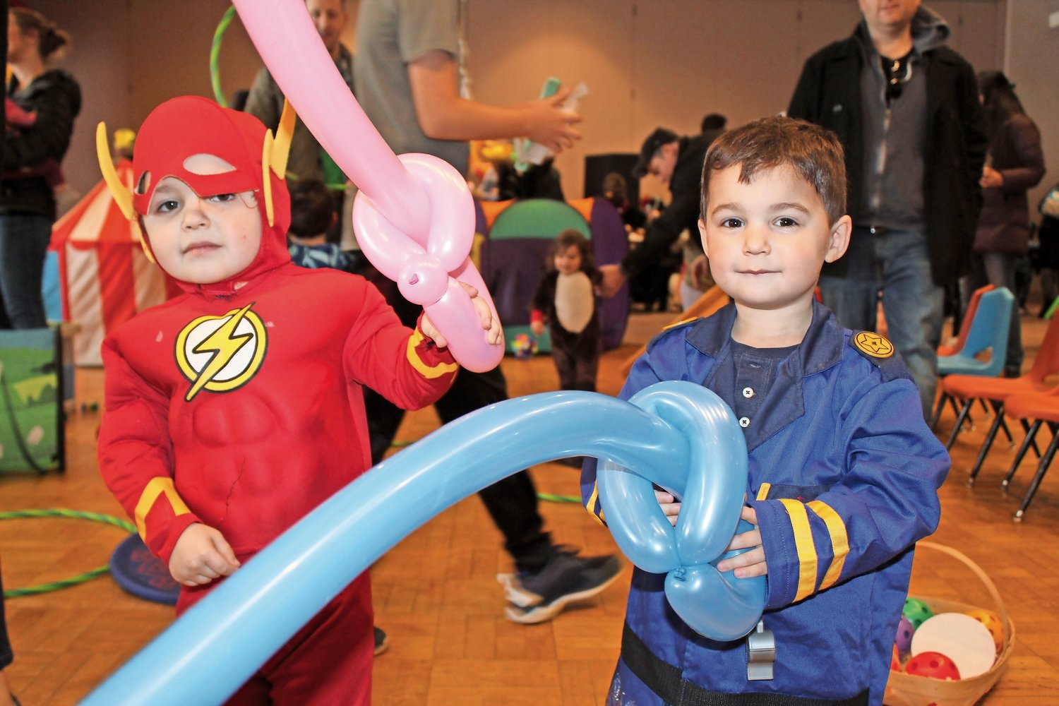 Superheroes-in-training Will, left, and Jake Kleinman, of Old Brookville, brandished their balloon swords.
