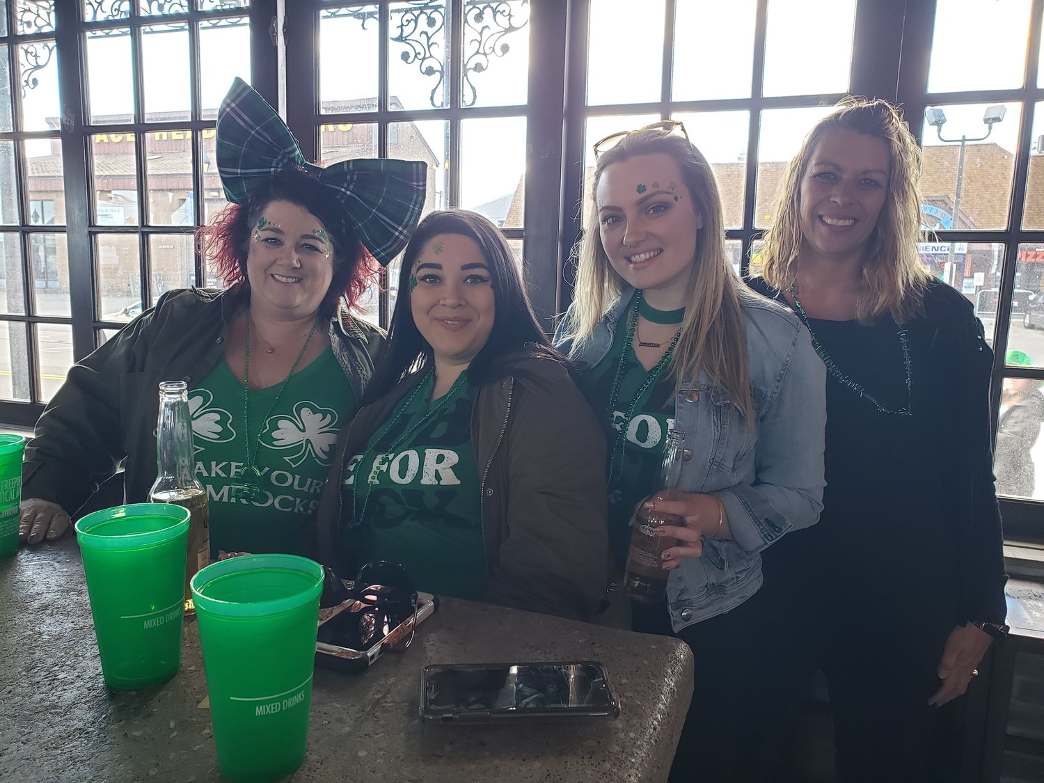 Starting the party at Nawlins Seafood Company, girlfriends Leeanne Urquilla, left, of Wantagh, Alexandria Rumbea, of Wantagh, Georgianna Hunter, of Levittown, and Melissa Kinlo, of Copiague, left, took part in the pub crawl, which was full of leprechauns.