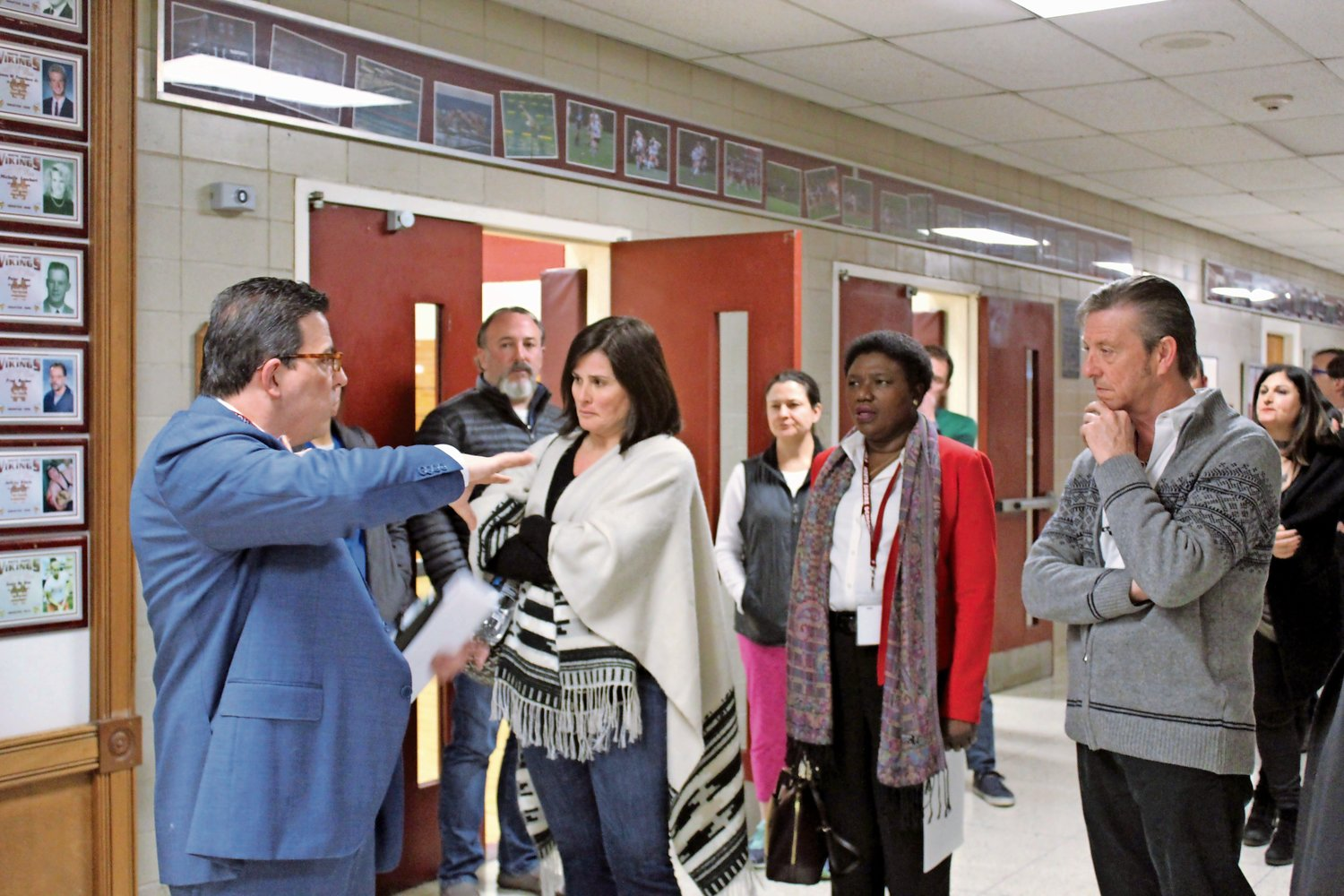 Superintendent Dr. Peter Giarrizzo, left, took community members on a tour of the district's polling place for the annual budget vote and trustee election, which will be held, as in prior years, in the North Shore High School gym.