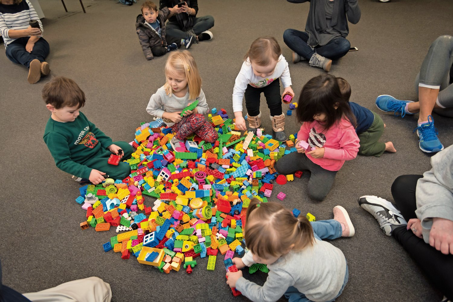 The toddlers descended on a pile of LEGOs in the Gold Coast Library annex.