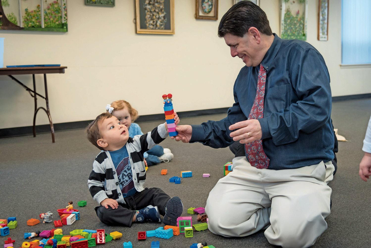 Ashton Stlyer, 1½, was eager to get his hands on the LEGO tower Jeffery Vasconi had made.