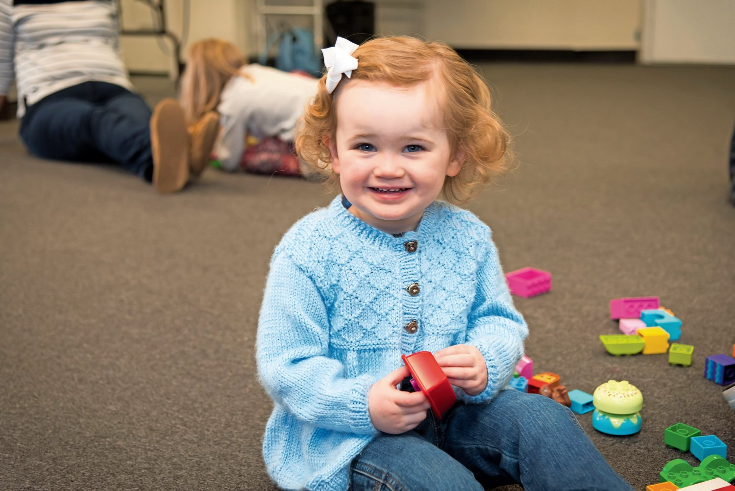 Caroline Reitzig, 2, was very happy to be building with LEGOs.