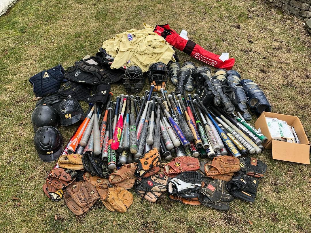 A small sample of the hundreds of gloves, bats, helmets and more collected by Goldstein and Soren for kids in South Africa.