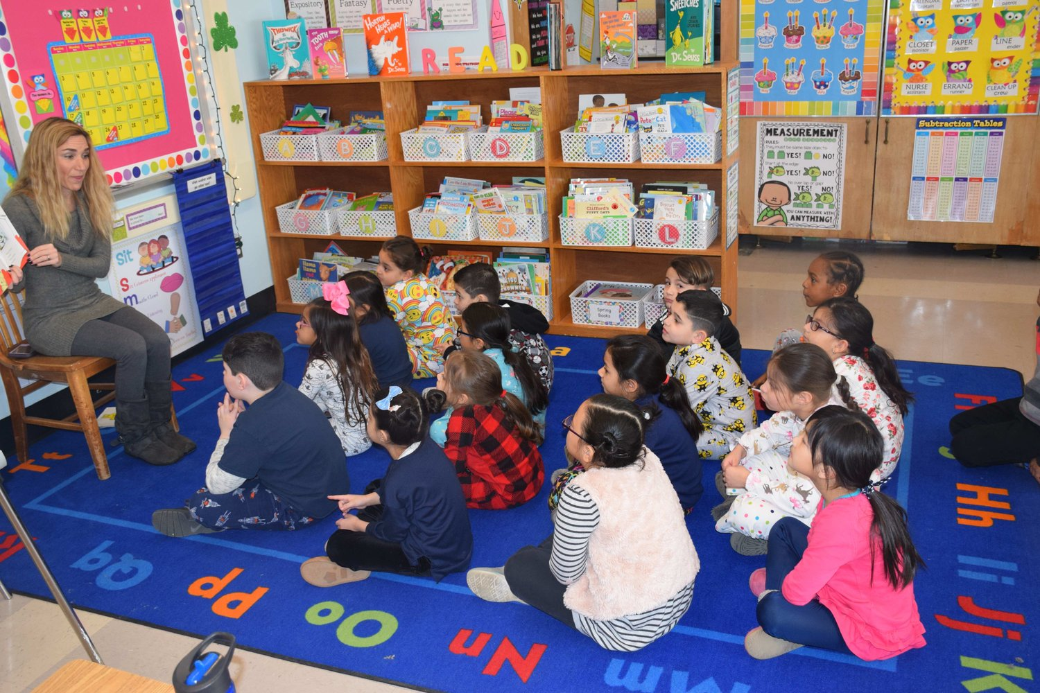 Parent-volunteer Tricia Barsuaskas read to a first-grade class at Bowling Green Elementary School.