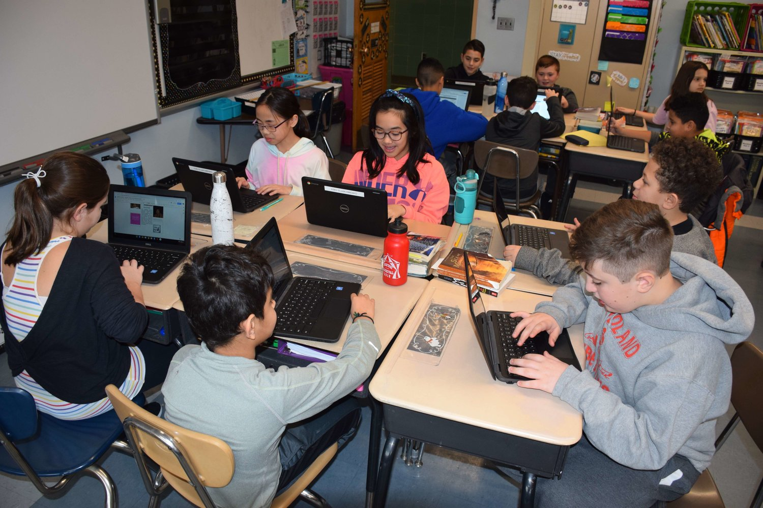 Fifth-grade students at Parkway Elementary School read their peers' projects from Black History Month utilizing Google Chromebooks on March 6.