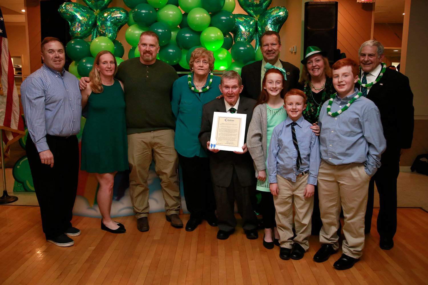 Honoree Edward Buckley of Buckley's and his wife Dolores, center, with their children, grandchildren and local officials at the Valley Stream American Legion on March 8.