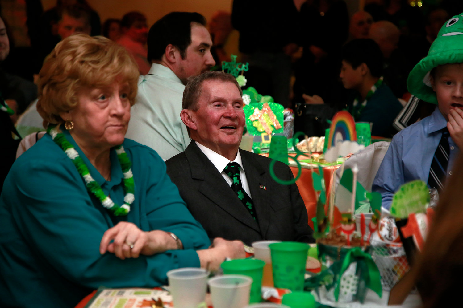 Edward Buckley listened to the opening remarks at the St. Patrick's-themed event held in his honor.