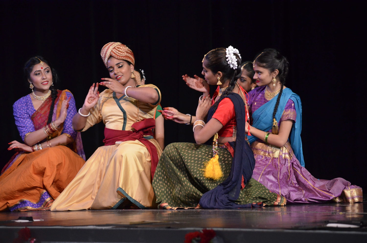 Dancers interpret the meaning of the festival in dance sequence.