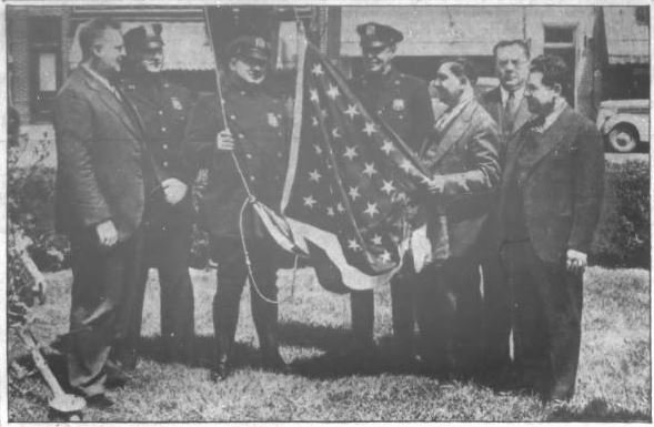 Fred Pieper, third from right, founded what went on to become the Oceanside Chamber of Commerce. Above, Pieper, on behalf of the Board of Trade, handed over a flag to a Nassau County patrolman that was flown on the Memorial Triangle.