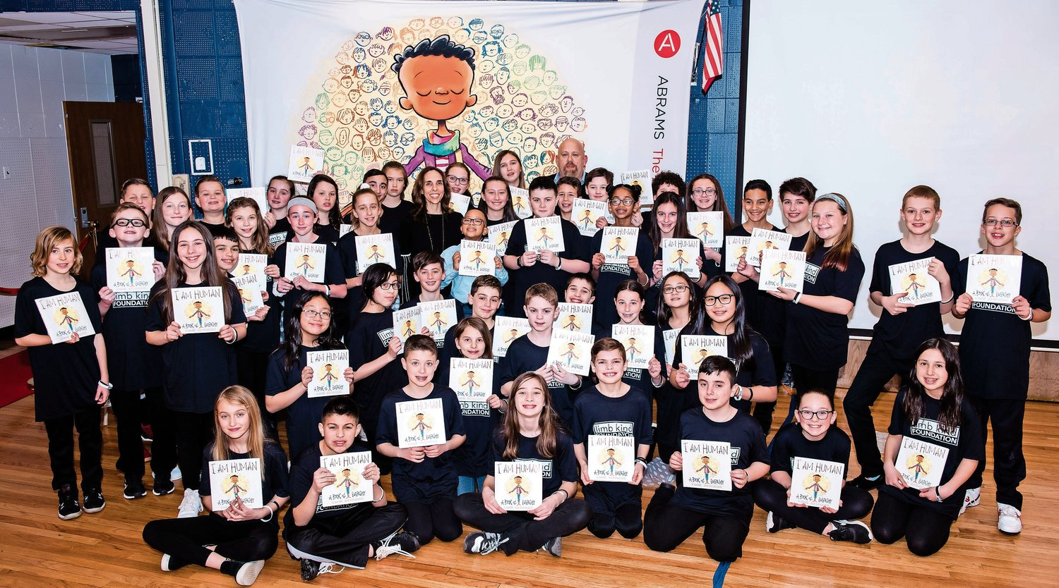 "The Project Extra class of 2019 received signed copies of ""I Am Human"" by Susan Verde, the book that inspired them to embark on a journey of kindness. They were joined by Limb Kind Foundation founder Robert Schulman and child ambassador Logan Passe at a celebration on March 19."
