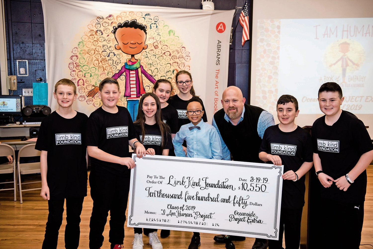Project Extra students presented a check for $10,550 to the Limb Kind Foundation, which donates prosthetics to children with limb loss domestically and internationally.