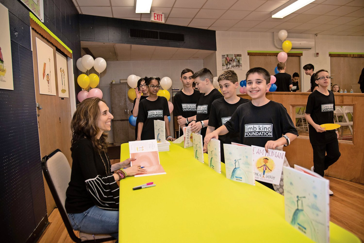 Author Susan Verde signed copies of her book for the 49 Project EXTRA students.