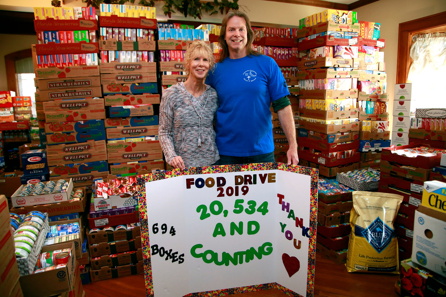 Mary and Rob Hallam collected more than 20,000 donations, both food and money, at their annual food drive on March 16.