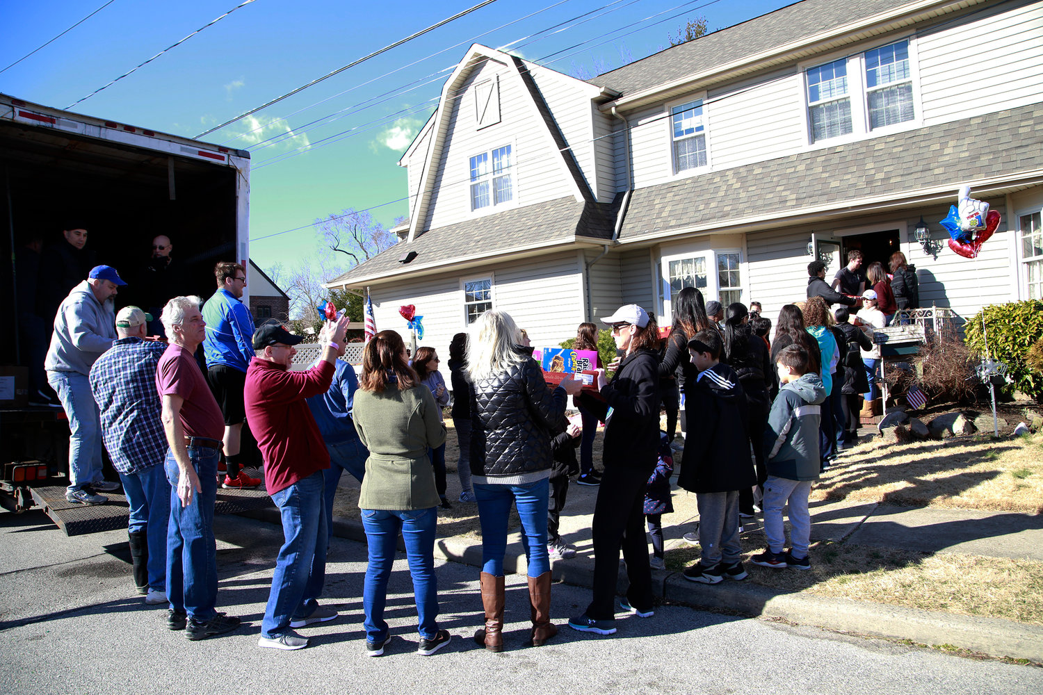 The Hallam home in Lynbrook was crowded with volunteers as they teamed up to fill a truck with donated food.