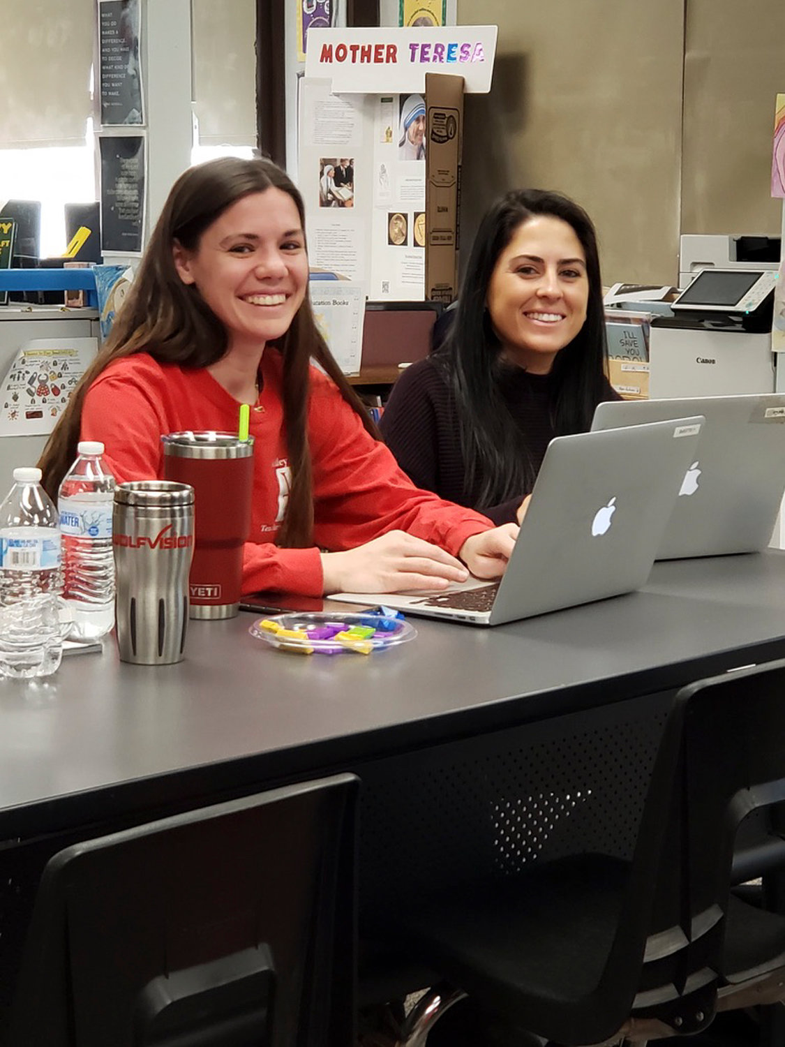 Teachers Kaitlyn Gillespie, left and Joanna Gallo trained in the use of the new technology.