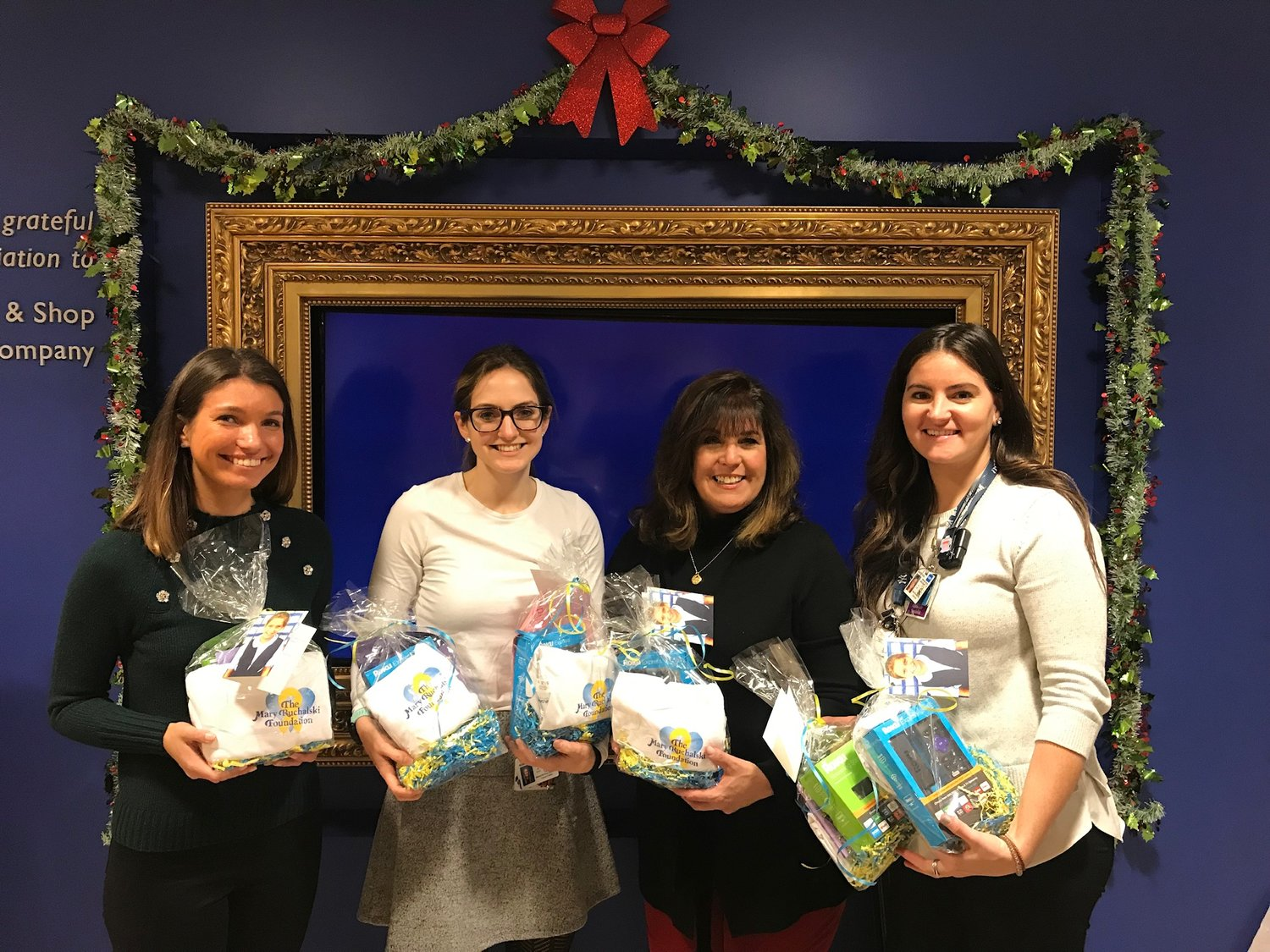 Mary's sister Lyndsey, far left, and mother, Carol, second from right, joined Abby Marriott, second from left, and Rachel Corner at Memorial Sloan Kettering Cancer Center in December to give Roku digital media players to patients.