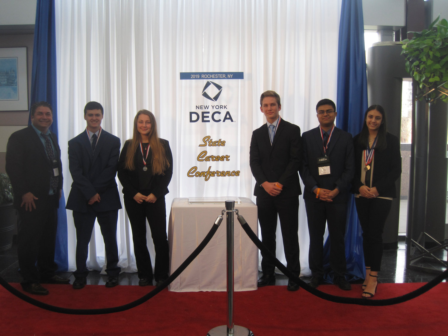 At the DECA State Career Conference in Rochester from left were club adviser Mark Albin, and students John Loughlin Jr., Brooke Kirchner, Luke Kirchner, Amil Virani and Danielle Hance.