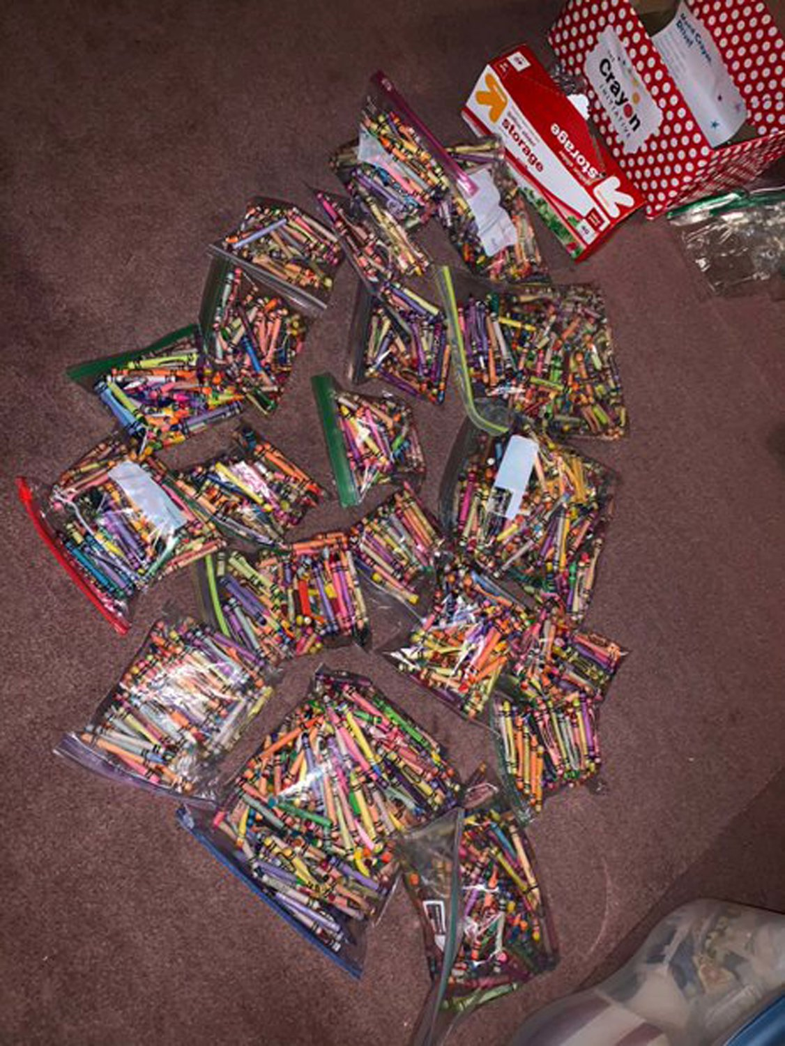Several bags of crayons collected for the Crayon Initiative.
