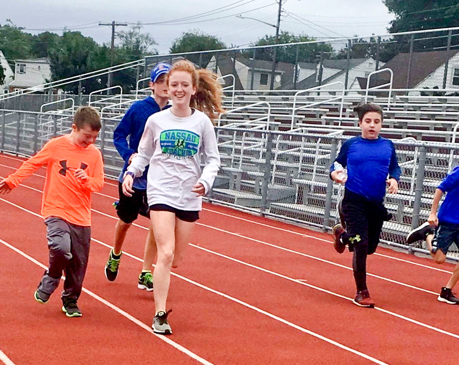 Sarah Keane with Shooting Stars athletes during a practice last spring.