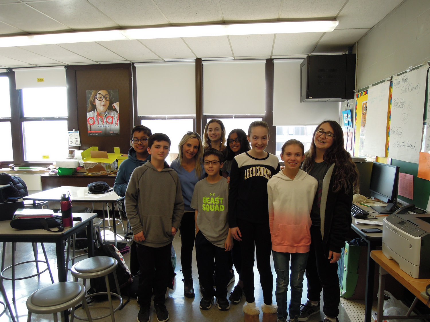 Wantagh Middle School's EsSCENTial Melts team won $10,000 in the annual Lead2Feed Student Challenge last month for a project addressing the mental health needs of their schoolmates and community. Teacher Patti Andreolas was third from left.