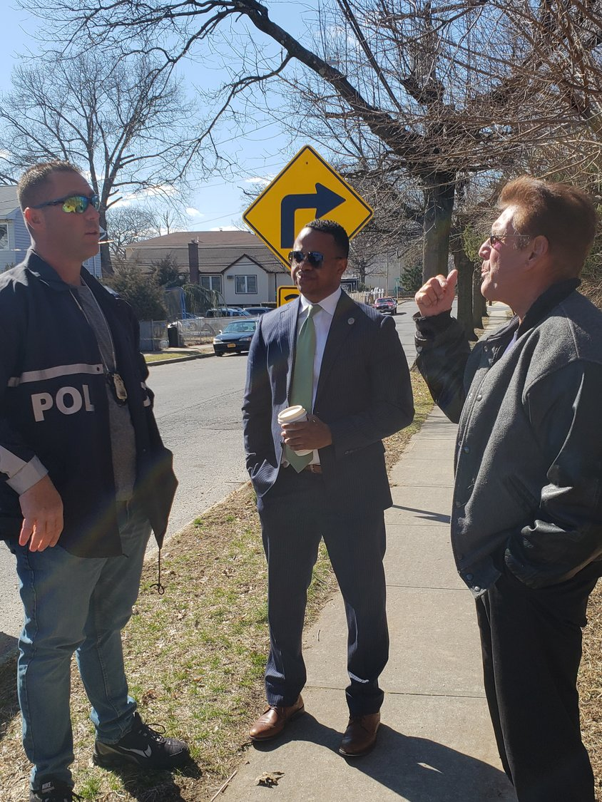 From left, Nassau County Police Department Sergeant Frank Discala, County Legislator Carrie Solages and Elmont-resident Andrew Prescia toured the polluted storm water basin site on March 17.