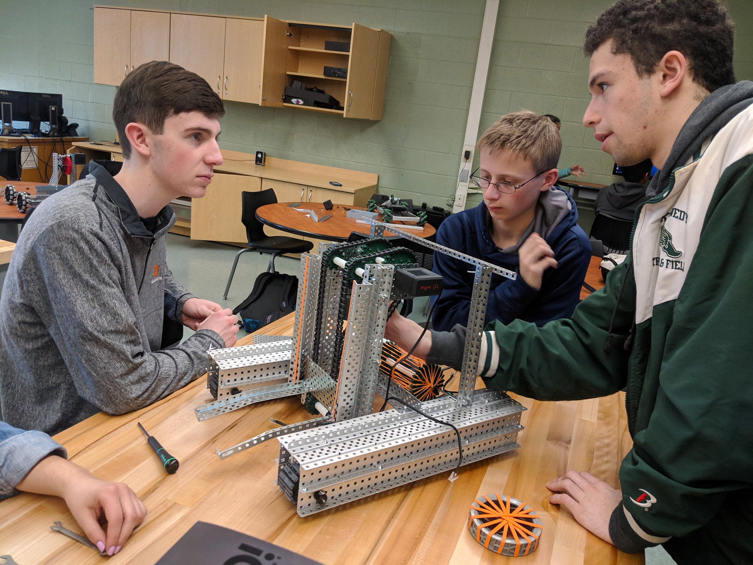 Cooper Moran, left, Jake Skolnik and Jordan Berke were in the first stages of building a robot for the Vex Robotics Turning Point Competition on March 20.