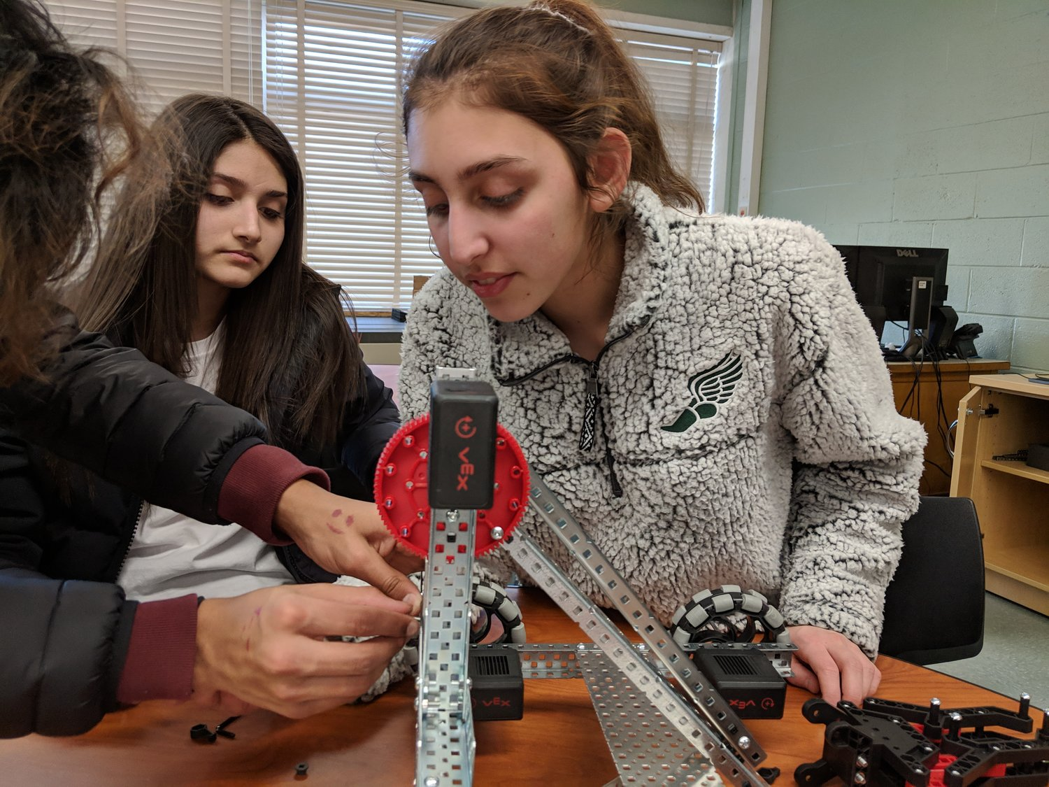 "Maya Spottiswood came in for an assist as her team rebuilt the robot from scratch. The first try ""just was not a good build,"" her teammate Connor Gibson said."