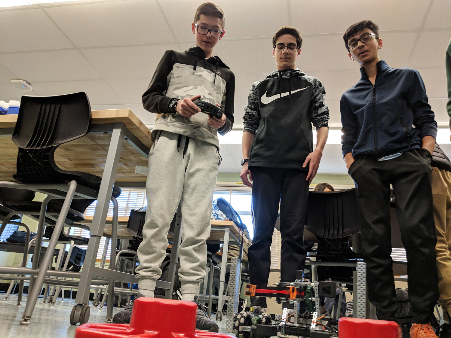Brandon Lin, James Lasalle and Arso Zafar demonstrated their robot's dexterity as it lifted and flipped plastic caps.