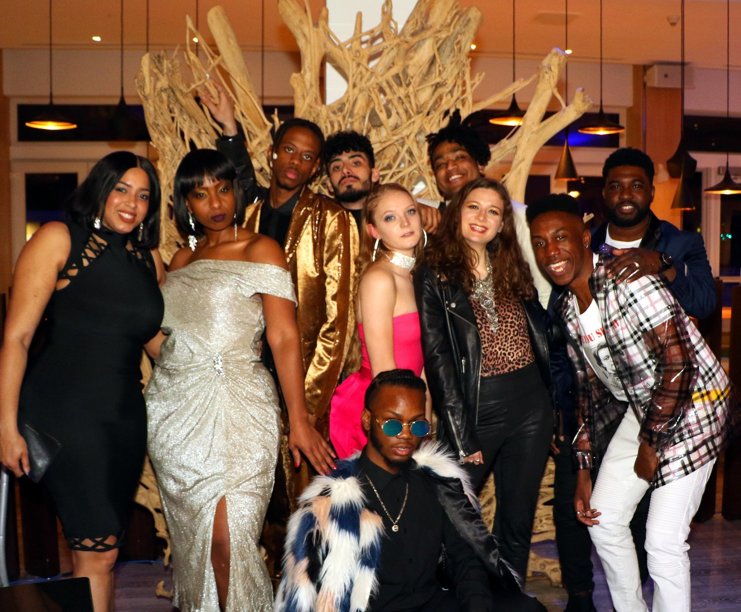 Local fashion stylist Chris Banks, in white at right, coordinated a fashion show with a group of models at the third annual Women in the Arts Awards and Recognition Party and Fundraiser at the Allegria Hotel on March 22.