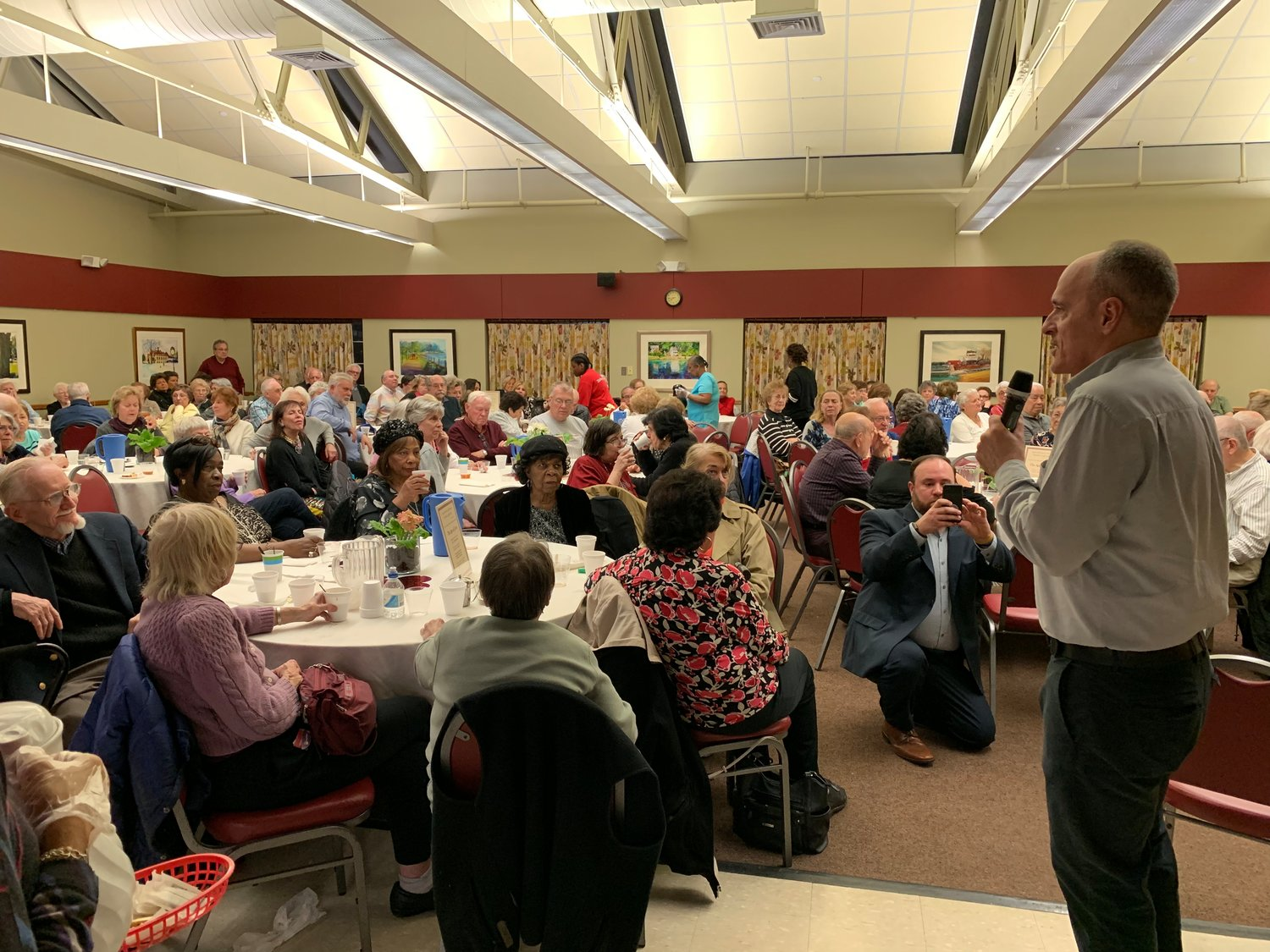 "Nearly 200 seniors watched ""The Age of Love,"" a documentary directed by Steven Loring, right, at the Glen Cove Senior Center."