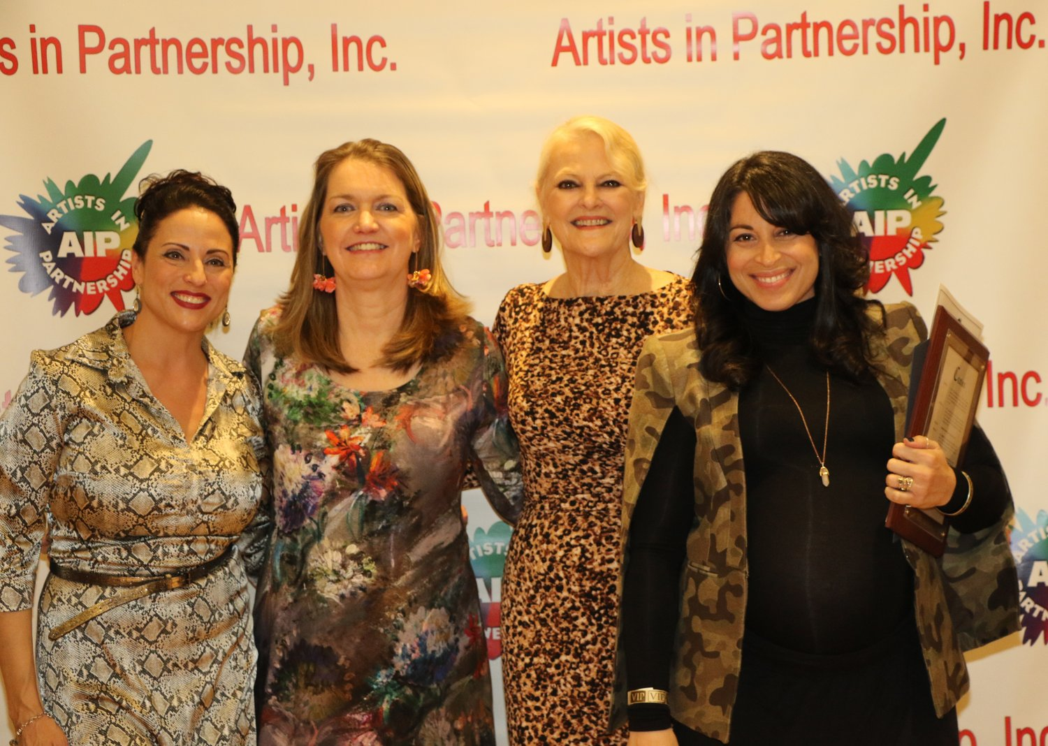 "Local musician and real estate agent J. Brittany DeVarso, far left; Elizabeth Connolly, director of development for the LBNY-Arts Council; and Johanna Mathieson-Ellmer, executive director of Artists in Partnership Inc., congratulated Stephanie Klemons, right, of Long Beach, the associate choreographer and global dance supervisor of the hit Broadway musical ""Hamilton."""