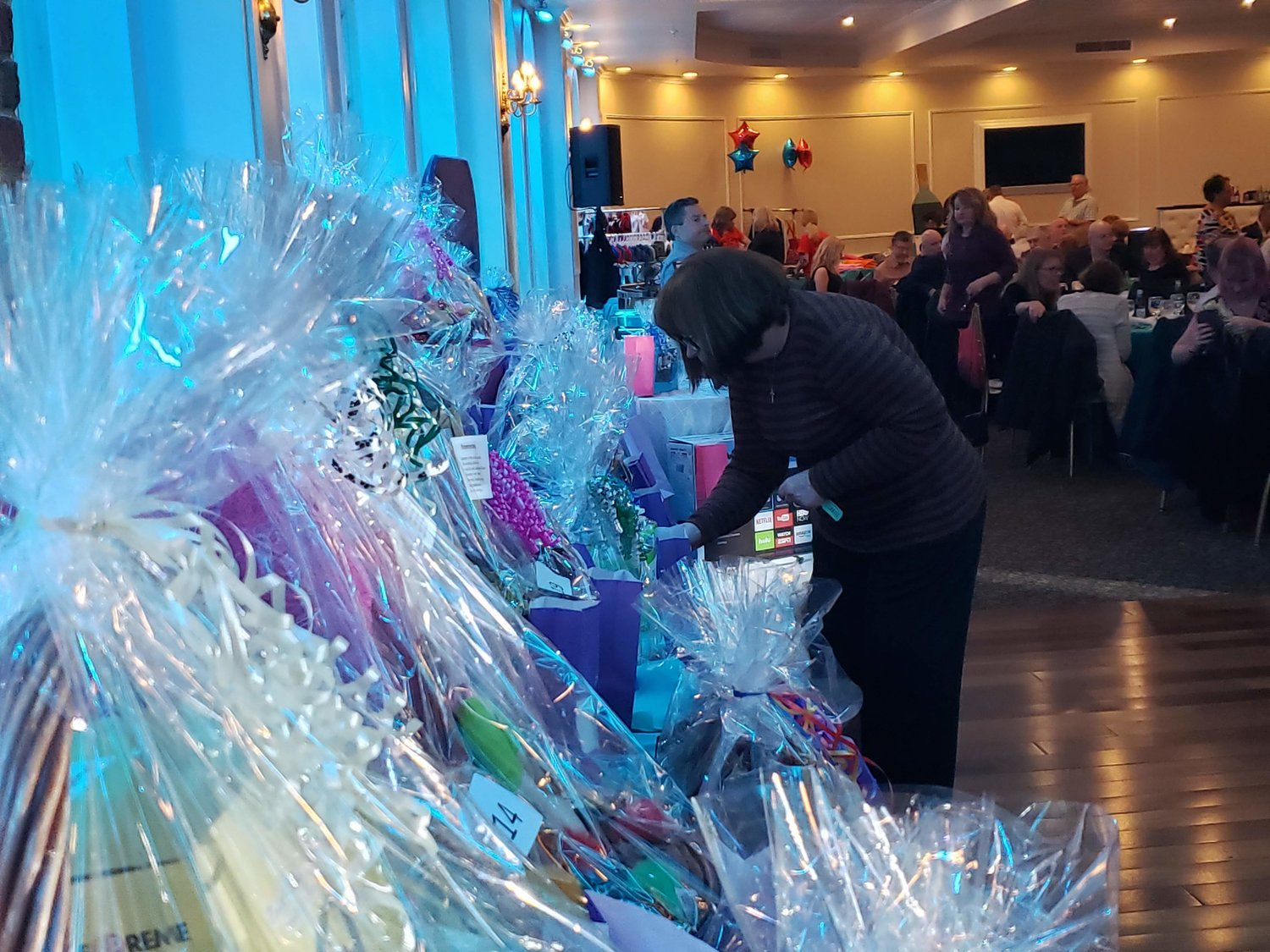 Queens Village resident, Ann Murphy perused the door prizes during the Bobbi and Strays Dinner Dance on March 13 at the Coral House.