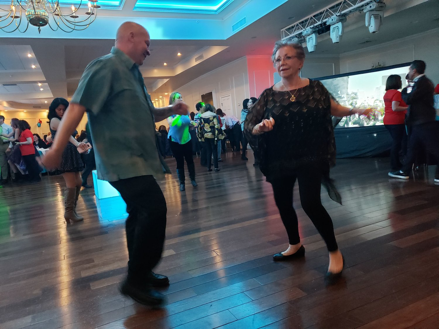 "Showing off their salsa dancing skills, Juan Rolon from Richmond Hill, left, danced with Rosemary Defrank from Mineola, to Marc Anthony's ""Vivir Mi Vida."""