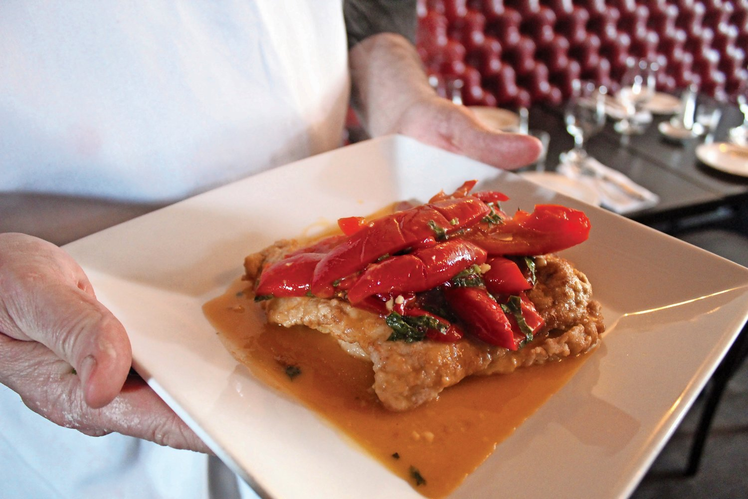 Cicinelli held a hearty plate of veal scaloppini draped with vinegar peppers.