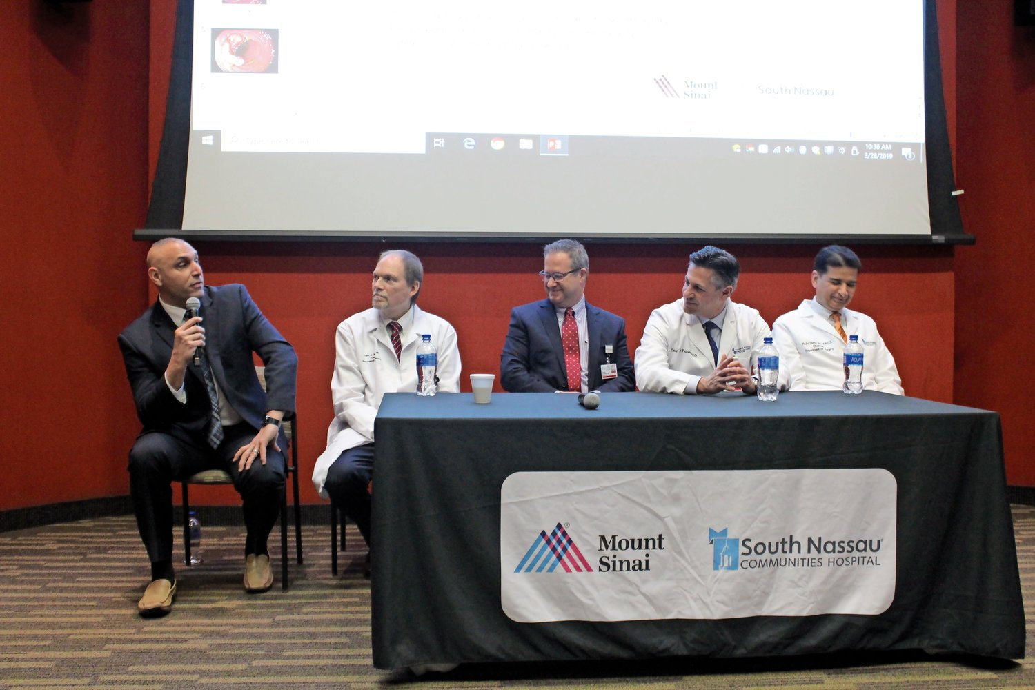 Merrick resident Eric Schrader, left, spoke about his experiences battling colon cancer. He was joined by Dr. Frank Gress, second from left, Dr. Frank Caliendo, Dr. Dean Pappas and Dr. Rajiv Datta, all of South Nassau Communities Hospital.