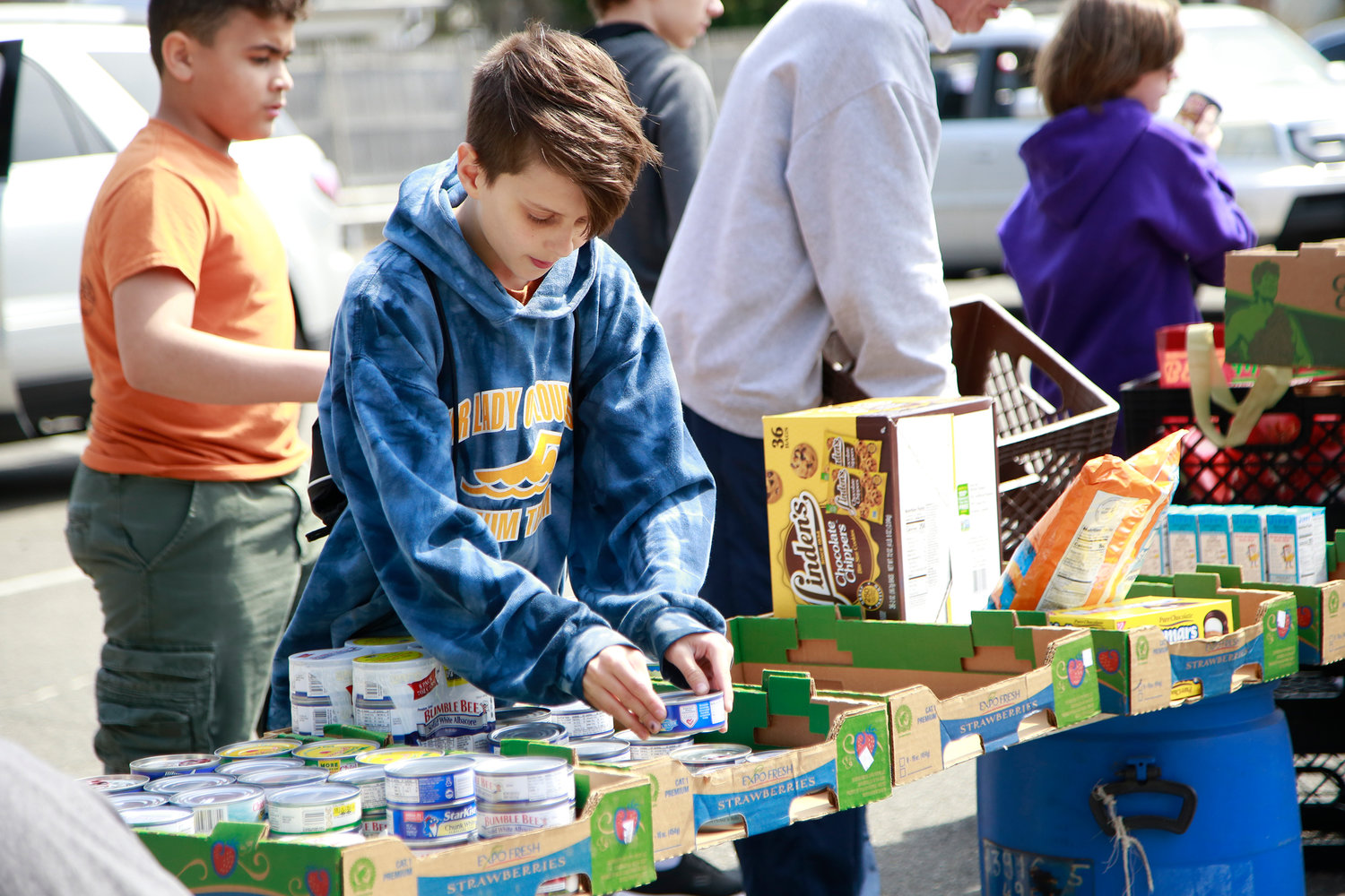 Team Troop 24 member James Castrofilippo organized his group's donations during Our Lady of Lourdes Church's Souper Scavenger Hunt last Saturday.